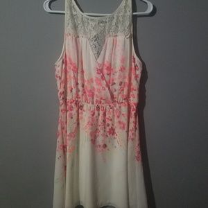 Very fun flirty dress. Lace and pink flowers.
